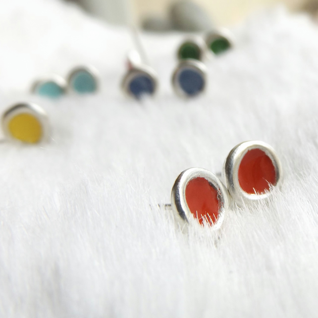 Red studs made from recycled sterling silver