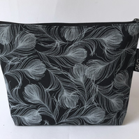 Handmade cotton feather print makeup bag.