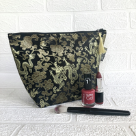 Large brocade makeup bag, black with gold dragons