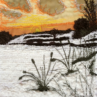 Up-cycled fabric embroidered textile sunset landscape.