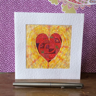 Handmade patterned red heart card.