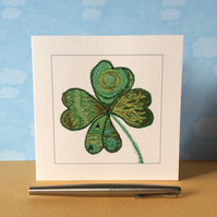 Patterned Four leaf Clover printed card.