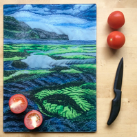Glass chopping board and work top saver.