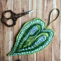 Handmade felt embroidered leaf decoration.