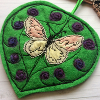Handmade leaf and butterfly felting wool and machine embroidered decoration.