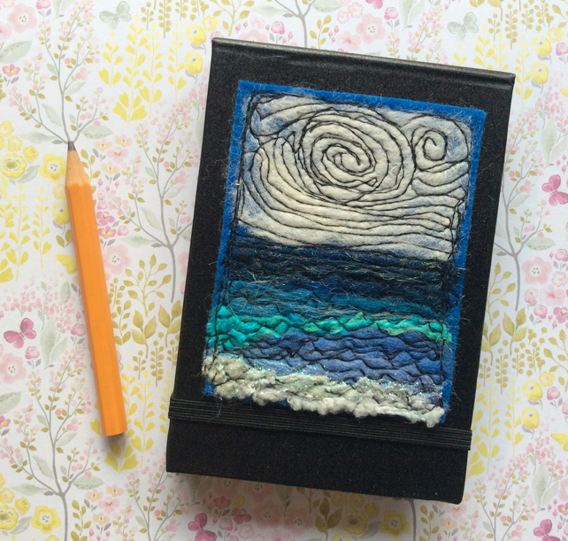 Embroidered pocket notebook.