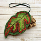 Felt handmade embroidered leaf decoration.