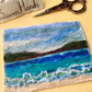 Embroidered seascape felt postcard.
