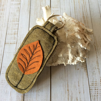 Up cycled embroidered leaf key ring.