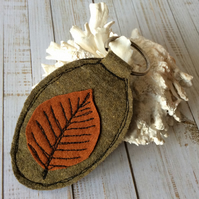 Up-cycled embroidered leaf key ring.