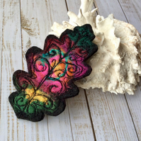 Embroidered leaf brooch.