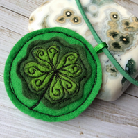 Handmade needle felted four leaf clover necklace.