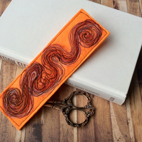 Dazzling swirly embroidered bookmark.