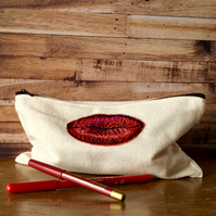 Embroidered zipped canvas make up bag, pencil case or jewellery bag.