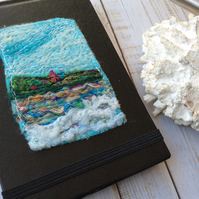 Embroidered seascape pocket notebook.