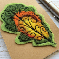 Embroidered leaf pocket notepad.