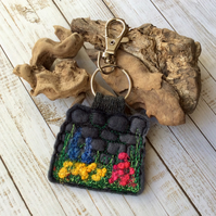 Embroidered flower keyring or bag charm.