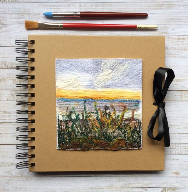Sunset seascape embroidered sketchbook, journal or scrapbook.