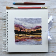 Embroidered sunset sketchbook, journal or scrapbook.