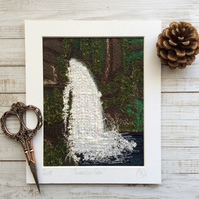 Embroidered waterfall landscape.
