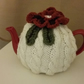 Cabled Cream tea cosy with large Brown flower decor