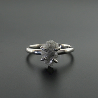 White diamond solitaire ring handmade in white gold with raw diamond.