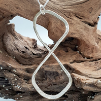 Silver hammered figure of eight infinity handmade pendant with chain.