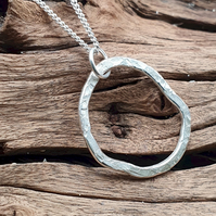 Sterling silver hammered small circle pendant complete with chain