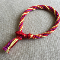 Cotton Kumihimo Bracelet in Red Pink Orange and Yellow