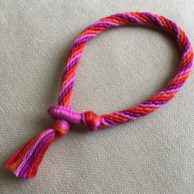 Cotton Kumihimo Bracelet in Red Orange Light and Dark Pink