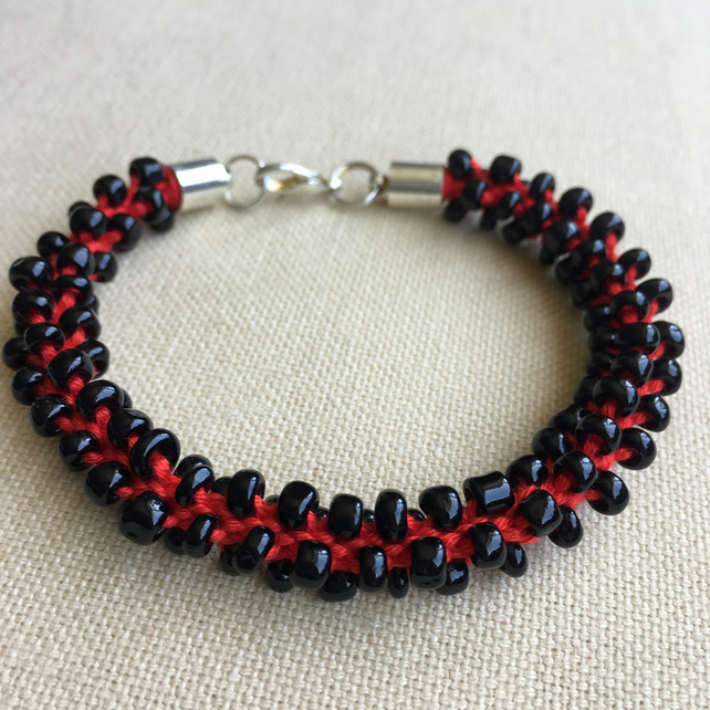 Red and Black Beaded Kumihimo Bracelet With Silver Coloured Clasp