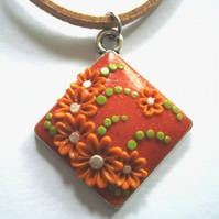 Shimmering Orange & Green Floral Polymer Applique Clay Pendant