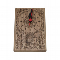 Small standing solid oak clock with floral design