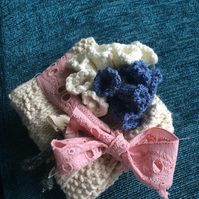 Knitted dish cloth country girl, and a bunch of hanging whitebells and bluebells