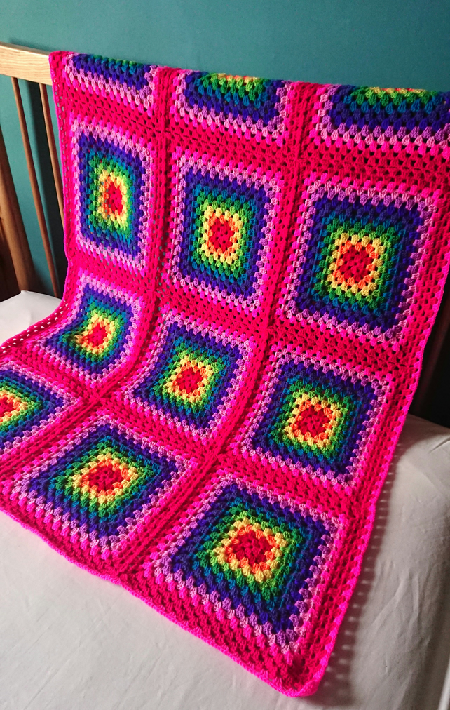 Bright rainbow granny square blanket or throw. Large. Pink border.