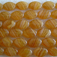 15 European glass oval beads, transparent amber
