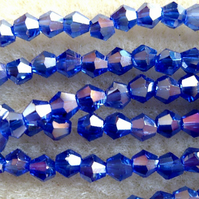 Strand 4mm crystal bicone beads, royal blue ab