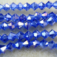 Strand 4mm crystal bicone beads, sapphire blue ab