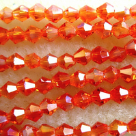 Strand 4mm crystal bicone beads, tangerine ab