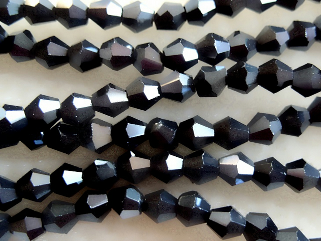 Strand 4mm crystal bicone beads, gunmetal