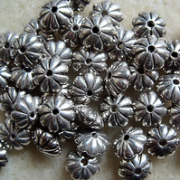 40 metallised floral rondelles, silver, 8mm