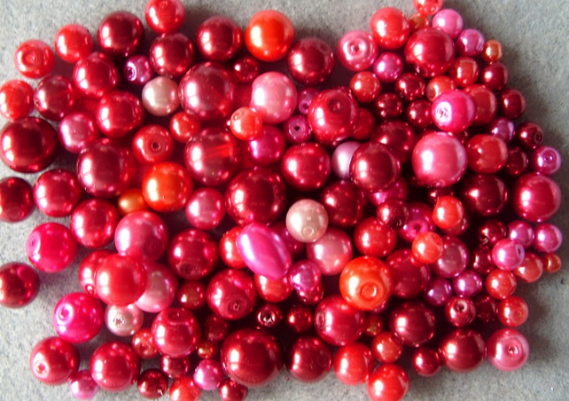 100g mixed glass pearls, pink, red, coral