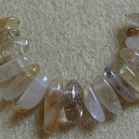 16 dog-tooth quartz gemstones, brown