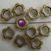 10, plated flower frame beads, antique brass