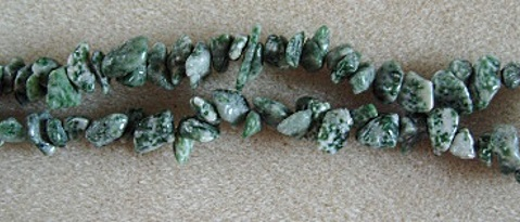 Green spot stone tumble chip beads. 9 inch strand