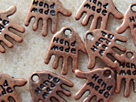10 hand made hand charms, antique copper