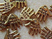 10 hand made hand charms, gold plated