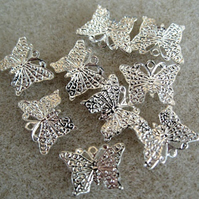 10 small silver plated butterfly charms