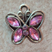 Butterfly pendant with pink faceted crystals, silver plated