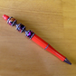 Flower print beaded pen, orange